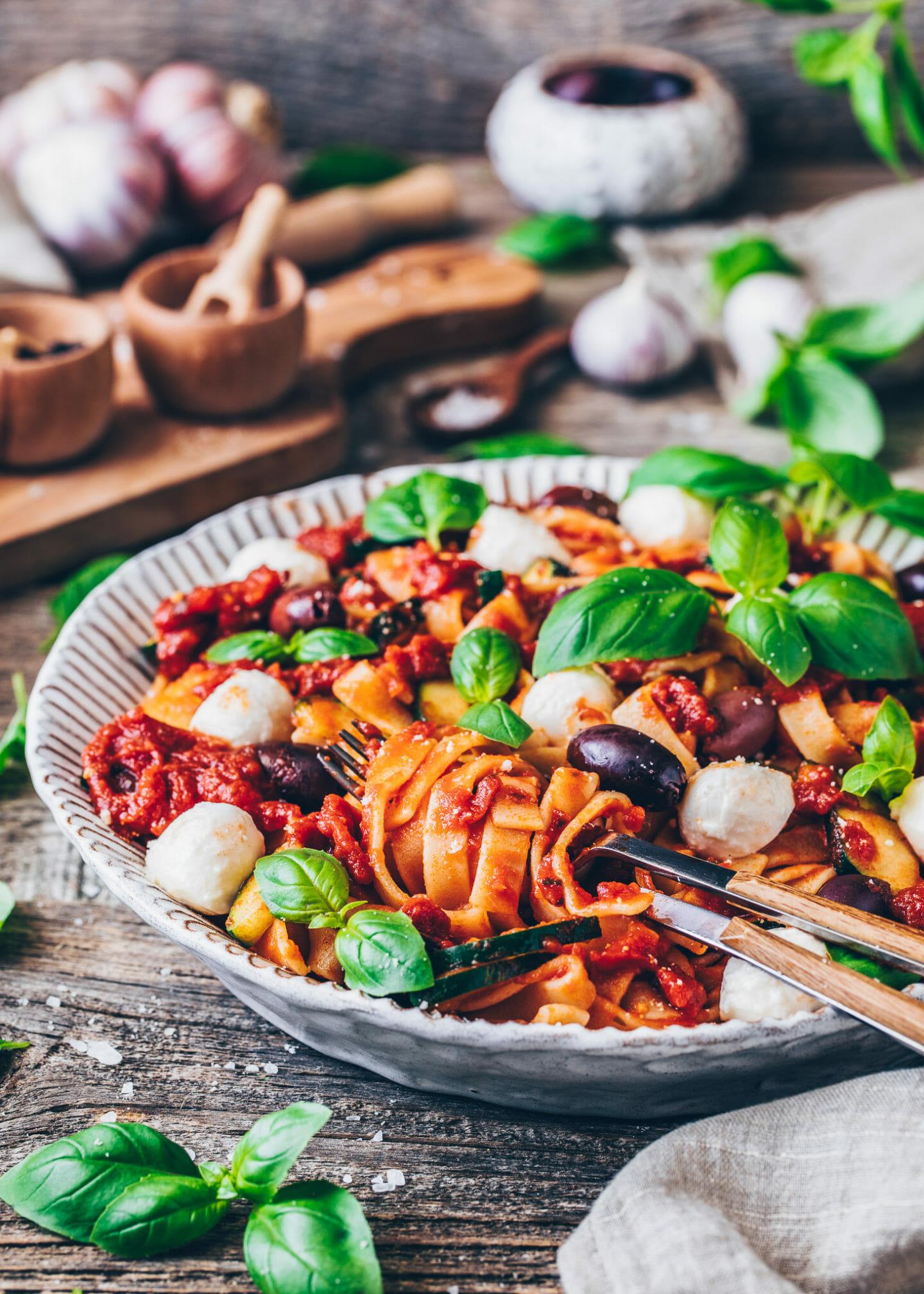 Tomato Pasta with Mozzarella, Parmesan, Olives, and Basil