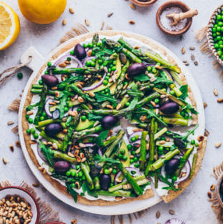 Green Goddess Pizza with Asparagus, Peas, Arugula, Onions, Avocado, and Pine nuts