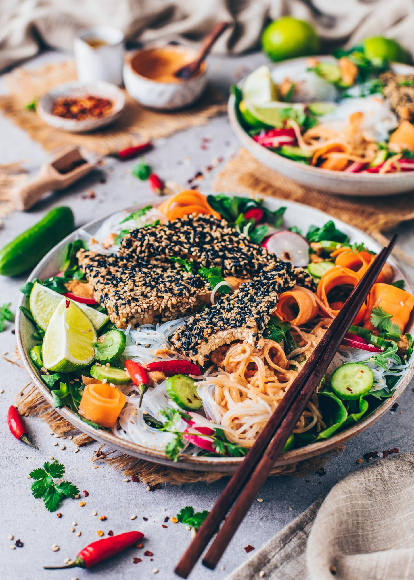 Thai Salad Bowl with rice noodles, crispy sesame tofu, carrots, radishes, lettuce, lemon, chili and peanut sauce dressing