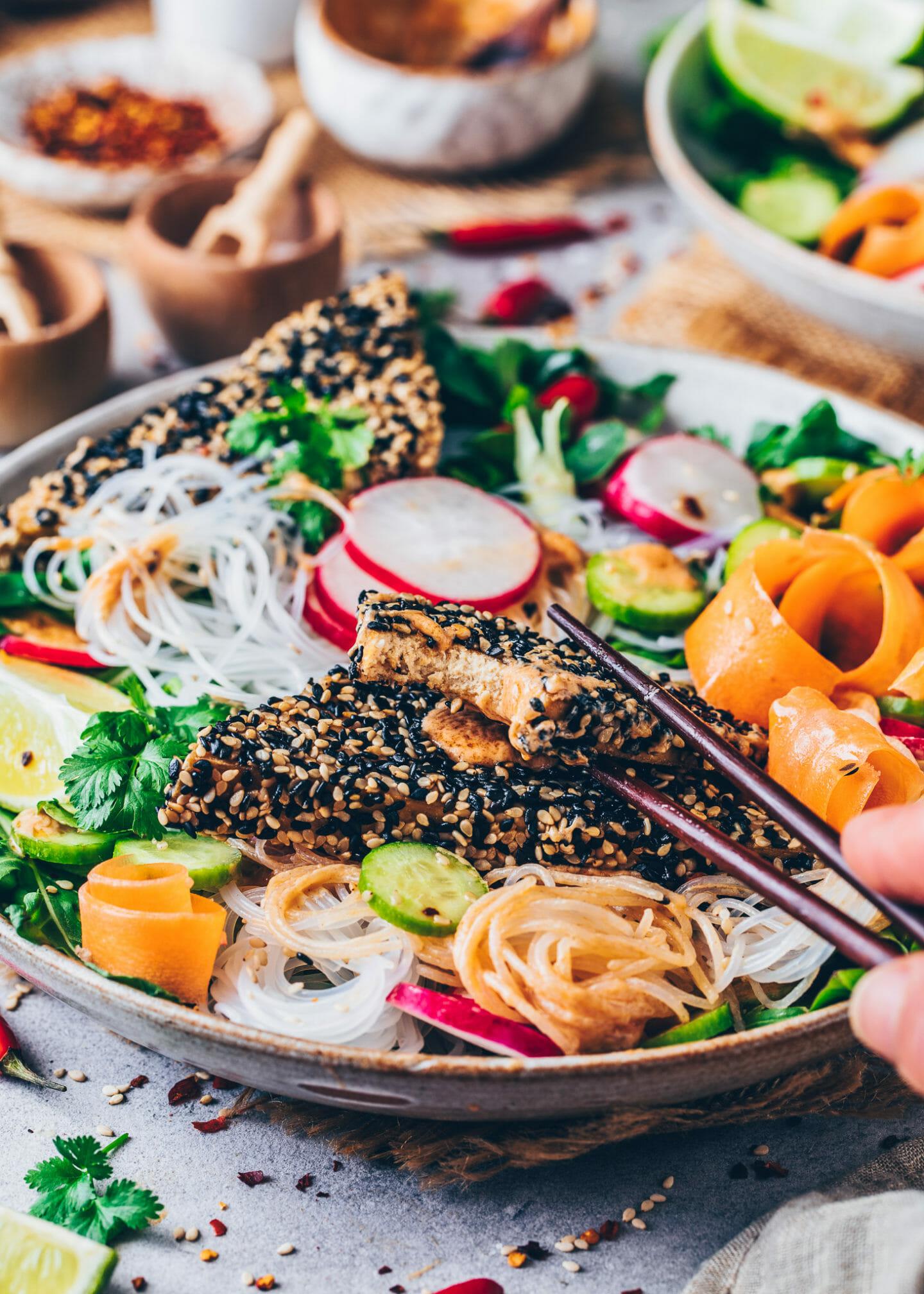 Rice Noodle Salad with crispy Sesame Tofu, carrots, radishes, lettuce, lemon, chili and peanut sauce dressing