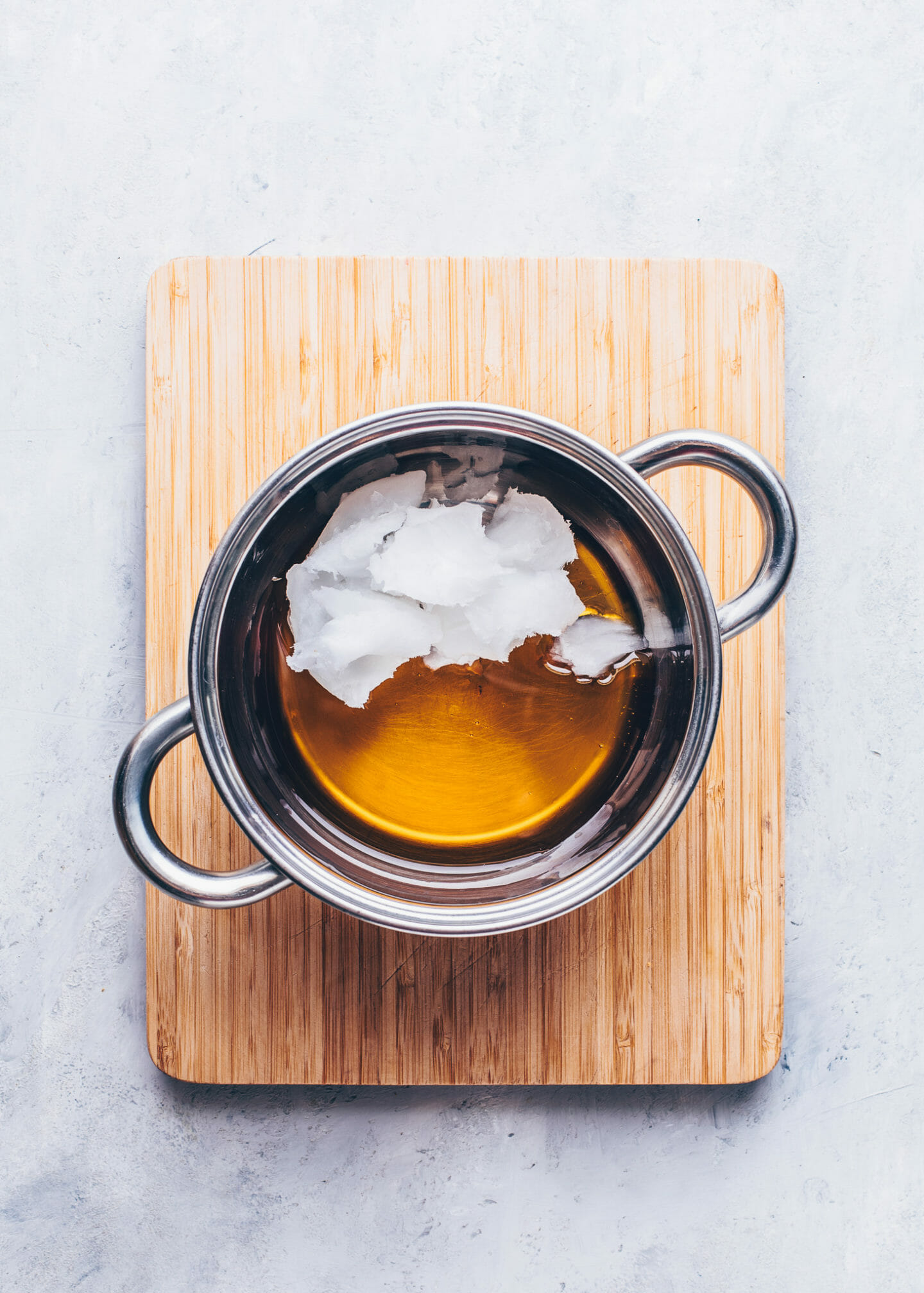 coconut oil and maple syrup in a saucepan