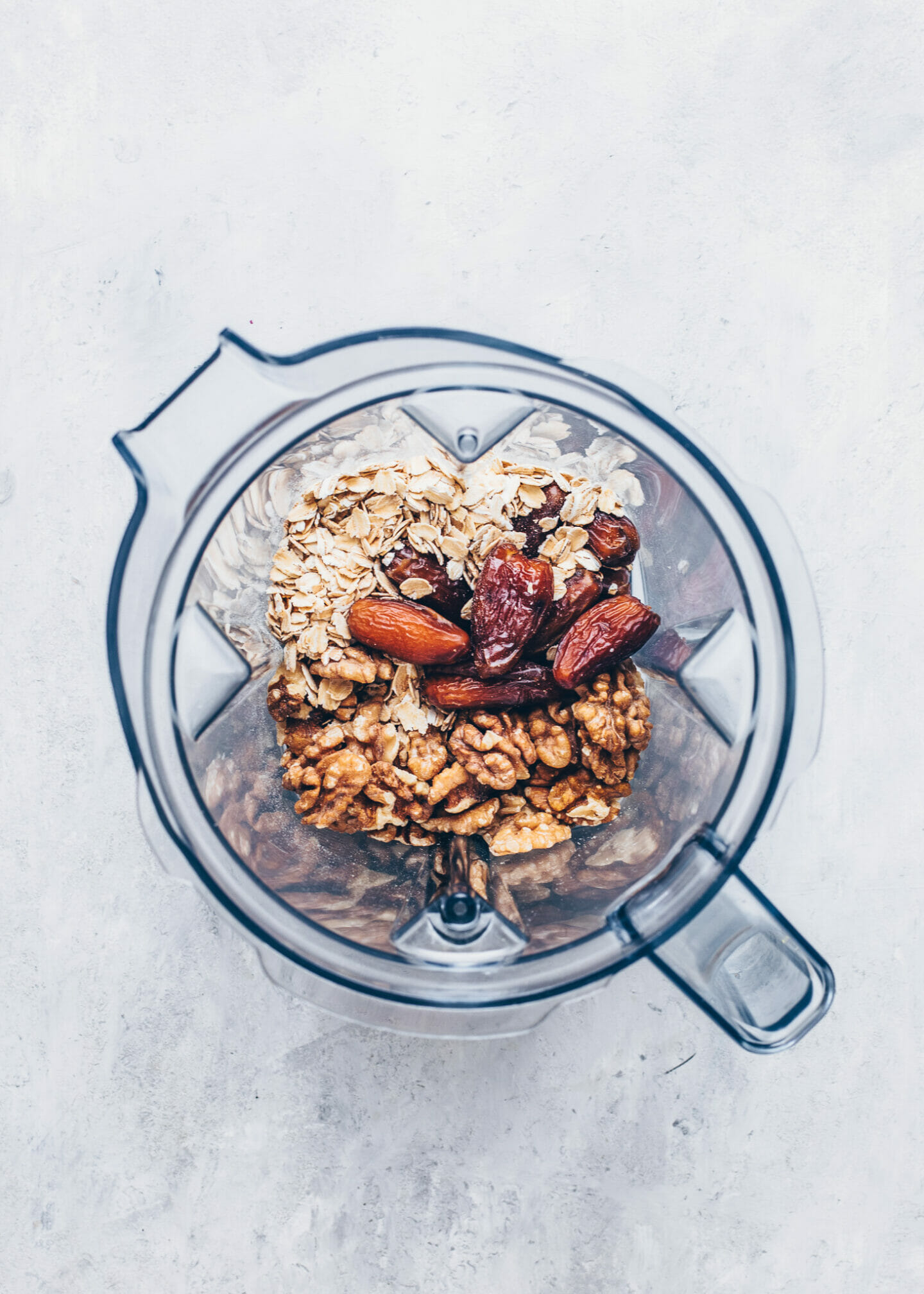 walnuts, oats, and dates in a blender for cheesecake crust