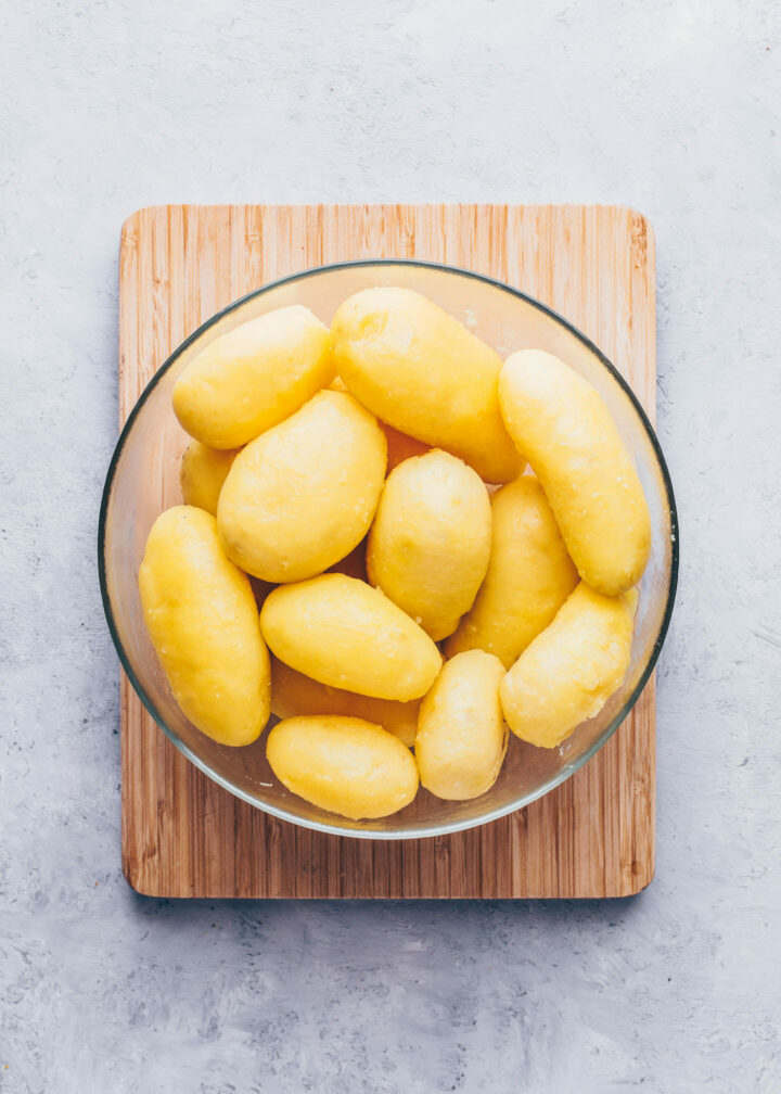 peeled cooked potatoes in a bowl