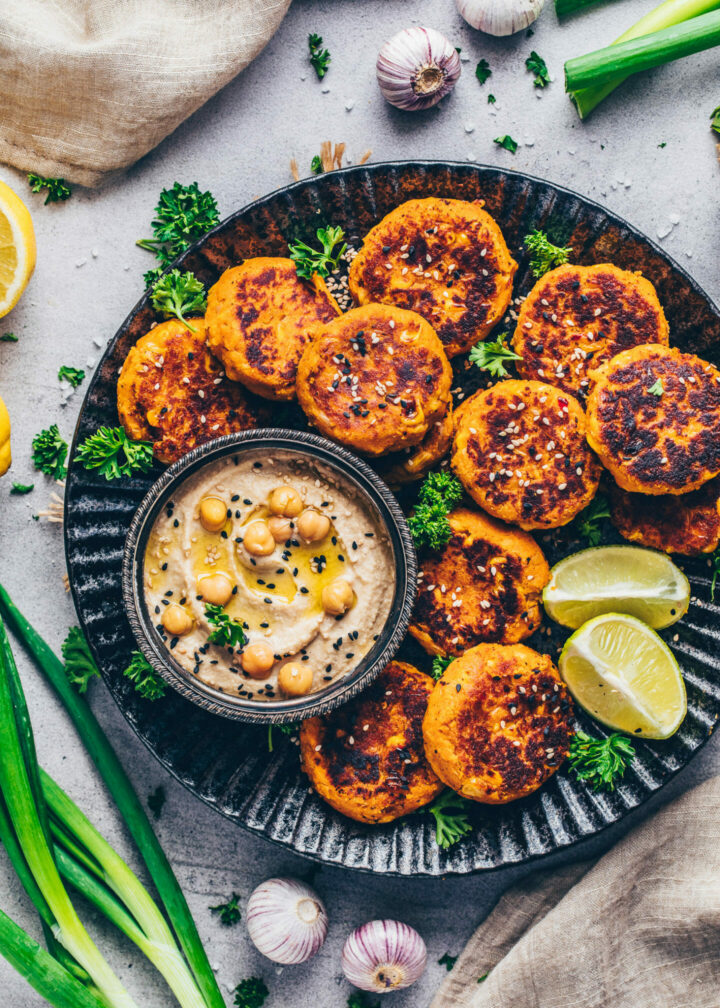 Sweet Potato Falafel with Hummus on a black plate