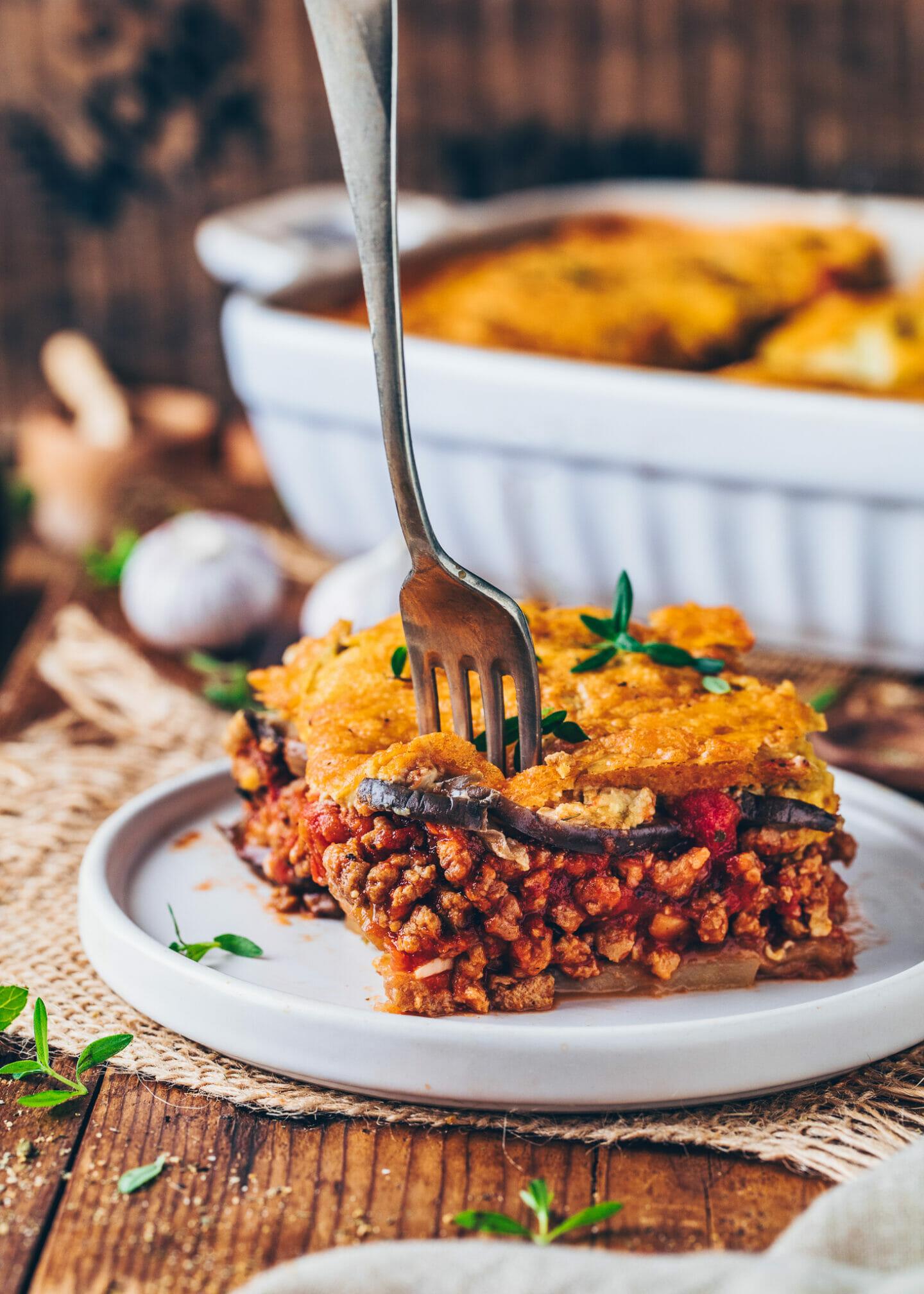 Moussaka with vegan meat tomato sauce and cashew béchamel (Greek eggplant lasagna)
