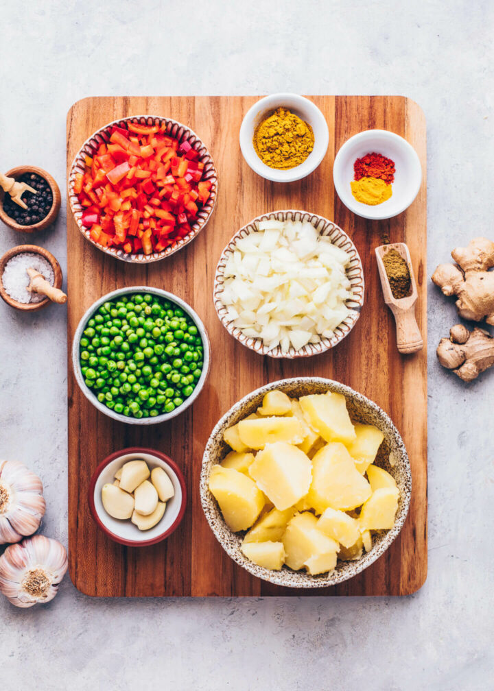 Ingredients for Samosa Filling: potatoes, peas, peppers, onions, garlic, ginger, curry powder, cumin, paprika powder, salt, pepper, chili, and turmeric