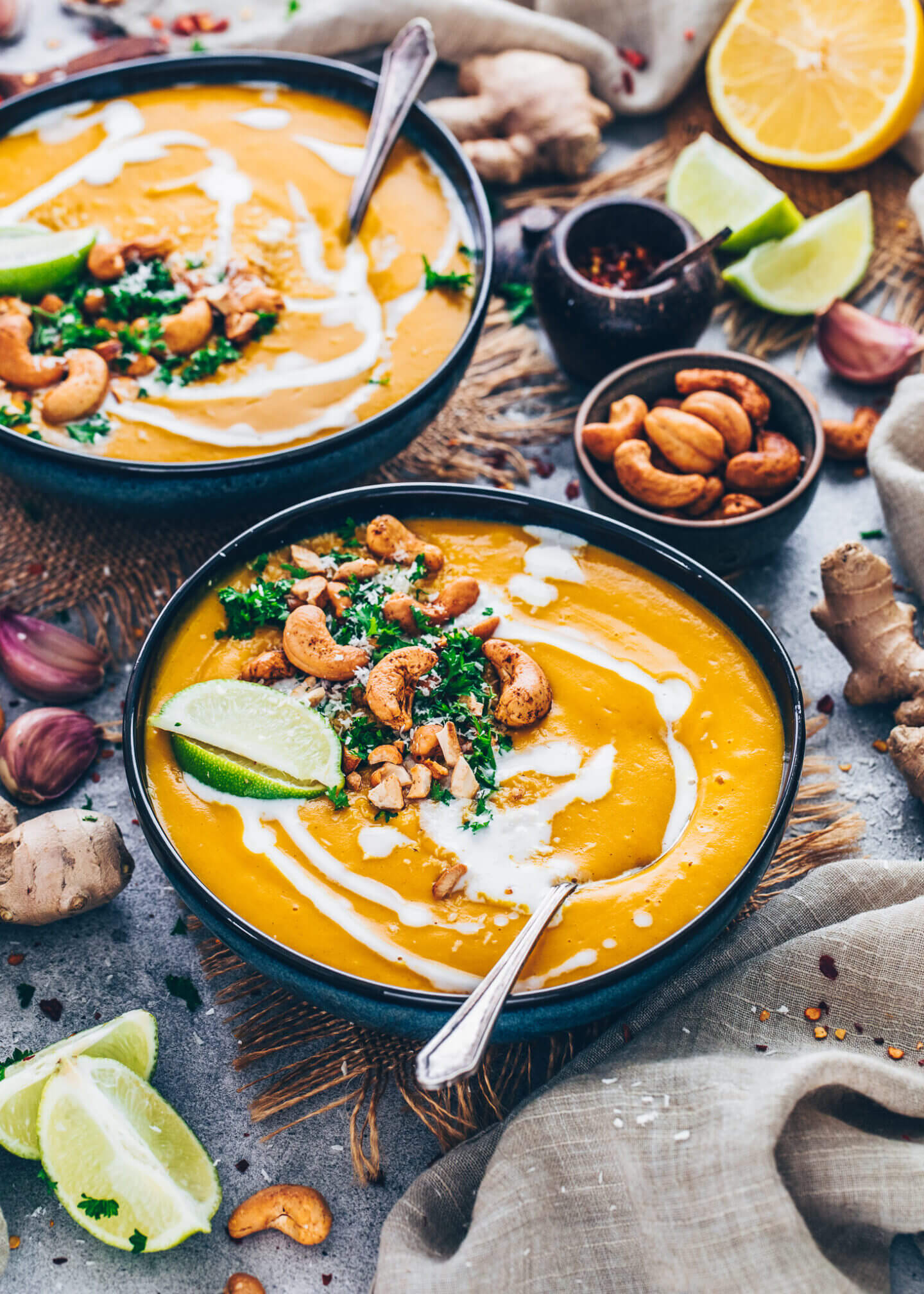 Carrot Ginger Soup with coconut milk, roasted curry cashews, fresh parsley, shredded coconut and lime wedges