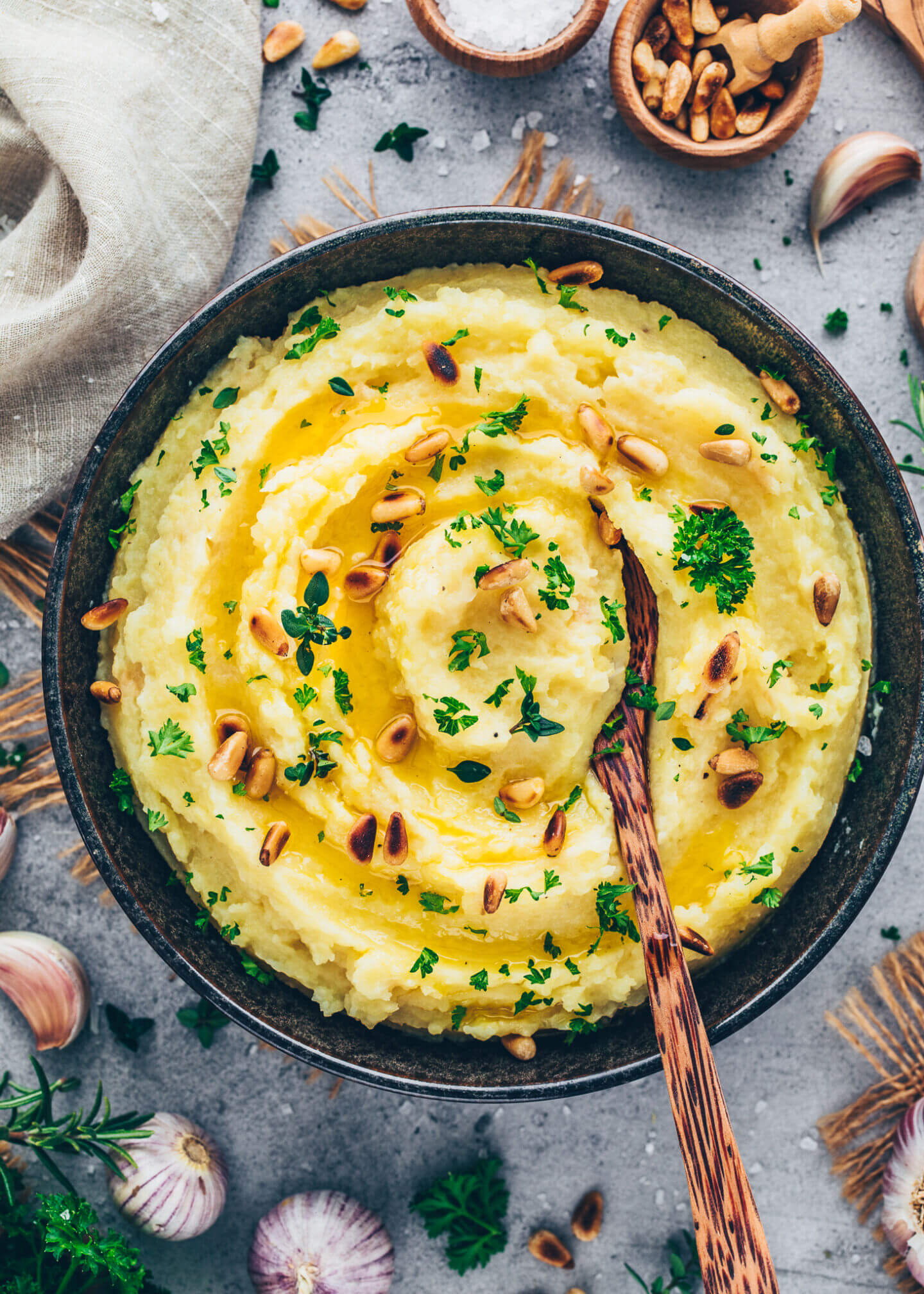 Best Mashed Potatoes with roasted garlic, parsley, thyme, olive oil, and pine nuts