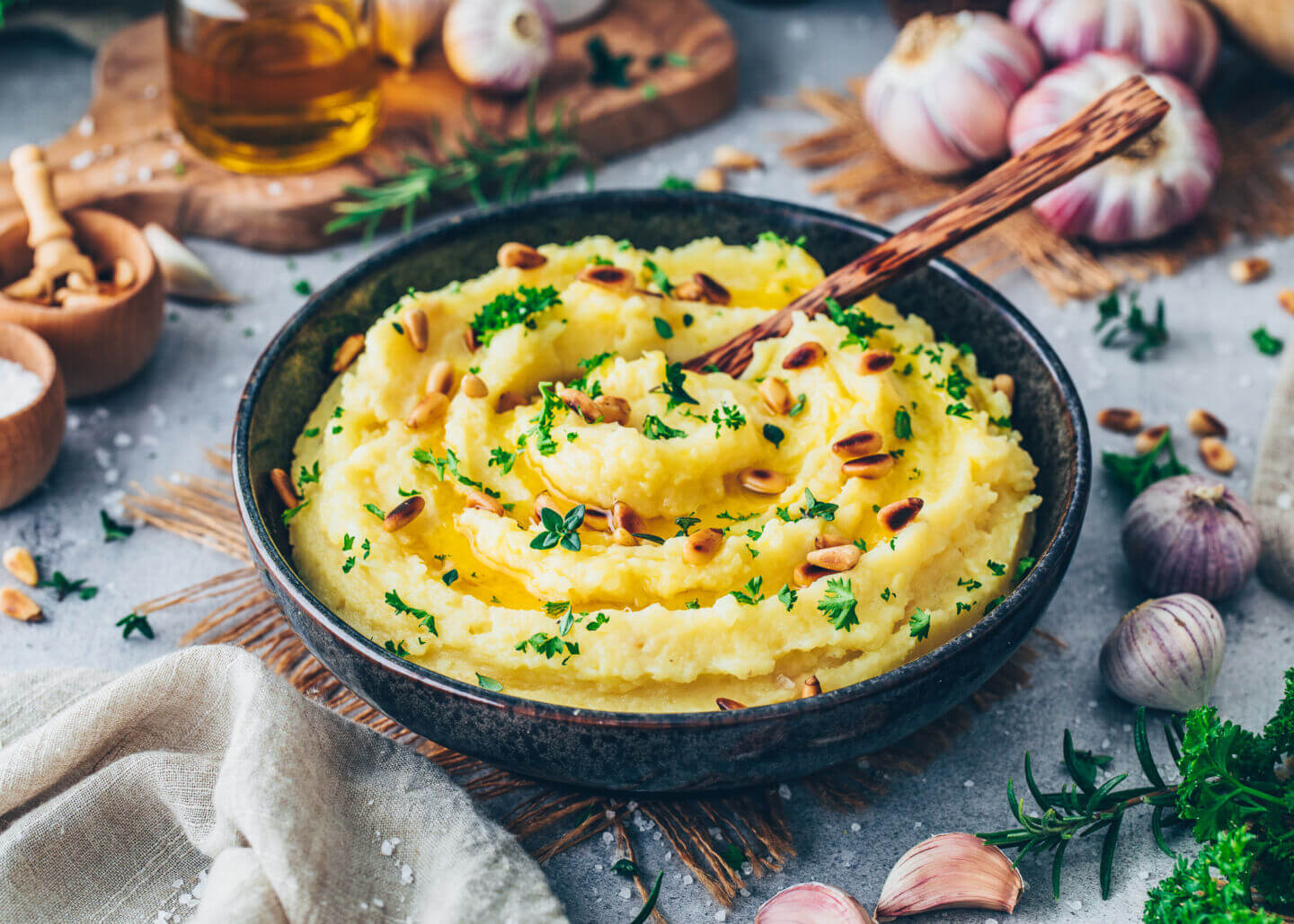 Vegan Mashed Potatoes with roasted garlic, parsley, thyme, olive oil, and pine nuts