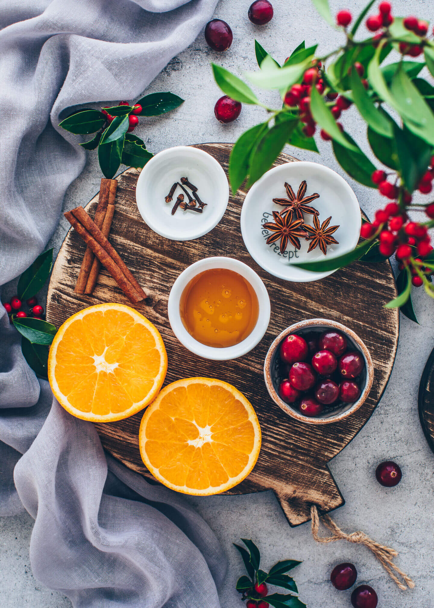 Mulled Wine Ingredients: red wine, oranges, cranberries, star anise, cloves, and cinnamon