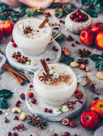 Vegan Eggnog Punch with cinnamon, pomegranate, apples and cranberries