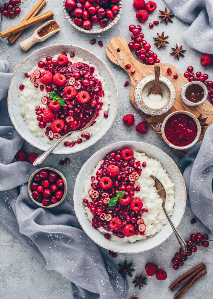 Coconut Rice Pudding served in bowls, topped with raspberry sauce and cinnamon