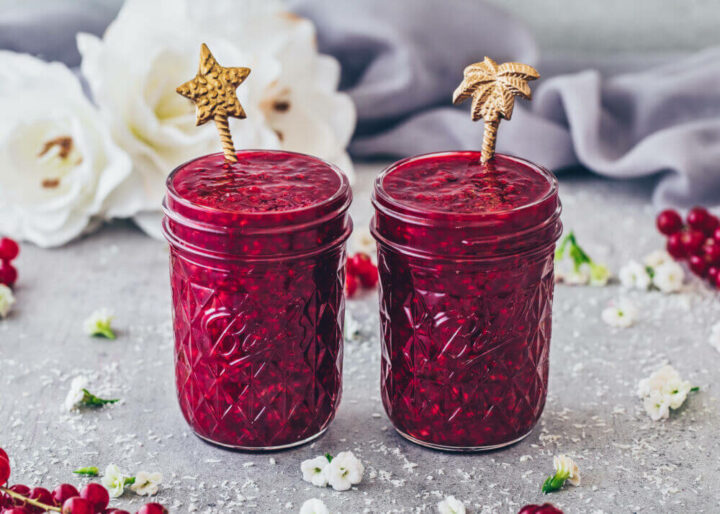 Raspberry Sauce in jars with golden spoons