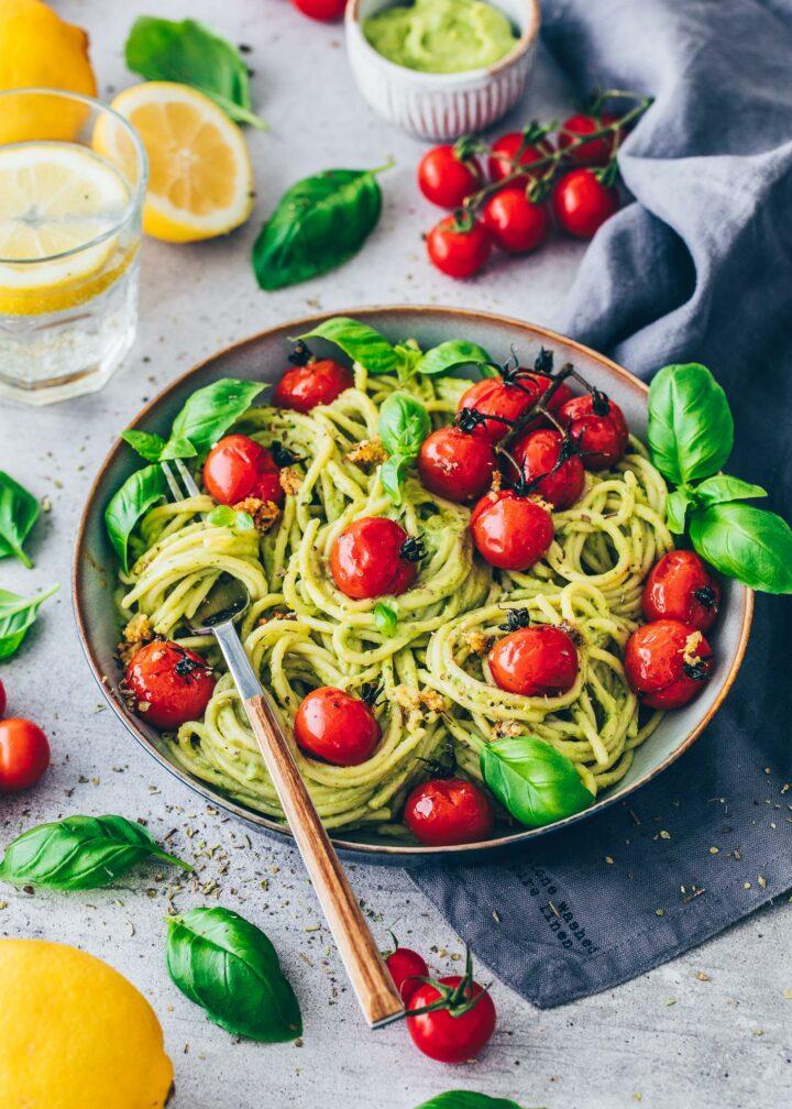 Pasta with avocado sauce, tomatoes, lemons and basil