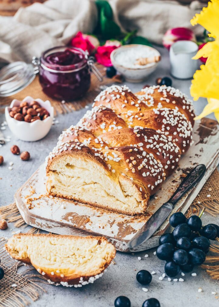 Braided Bread Challah with hail sugar, hazelnuts, grapes, ham, and flowers