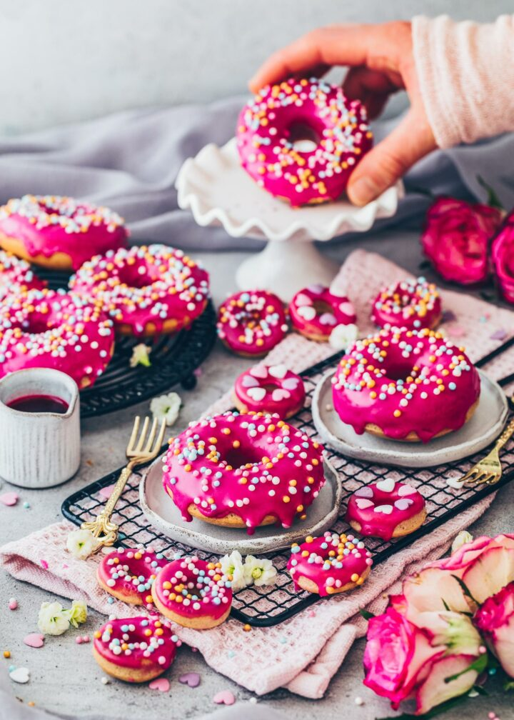 Donuts with pink beet glaze and sprinkles (food photography)