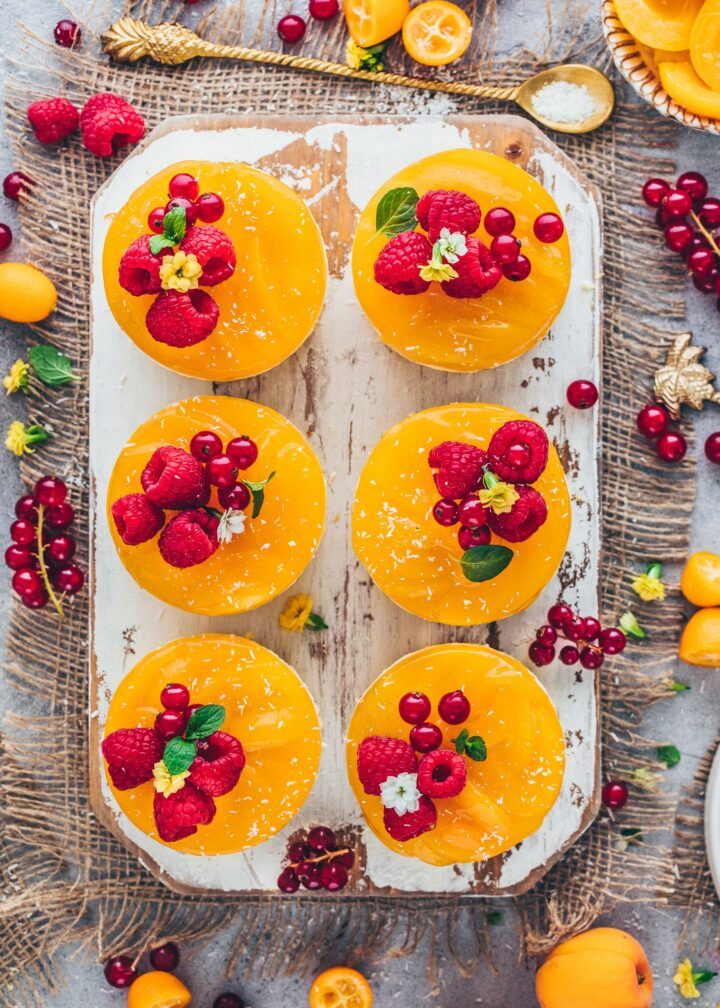Apricot Cakes decorated with raspberries and red currants
