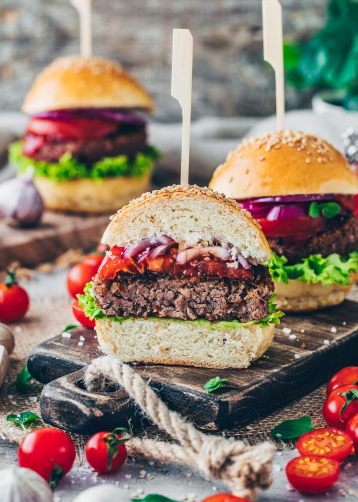 Homemade Burger buns with vegan patty, lettuce, tomatoes, onions and ketchup