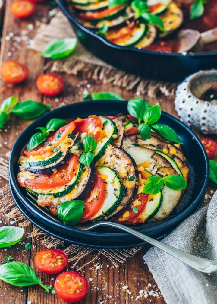 oven-roasted eggplant, zucchini, tomatoes, and basil on a plate