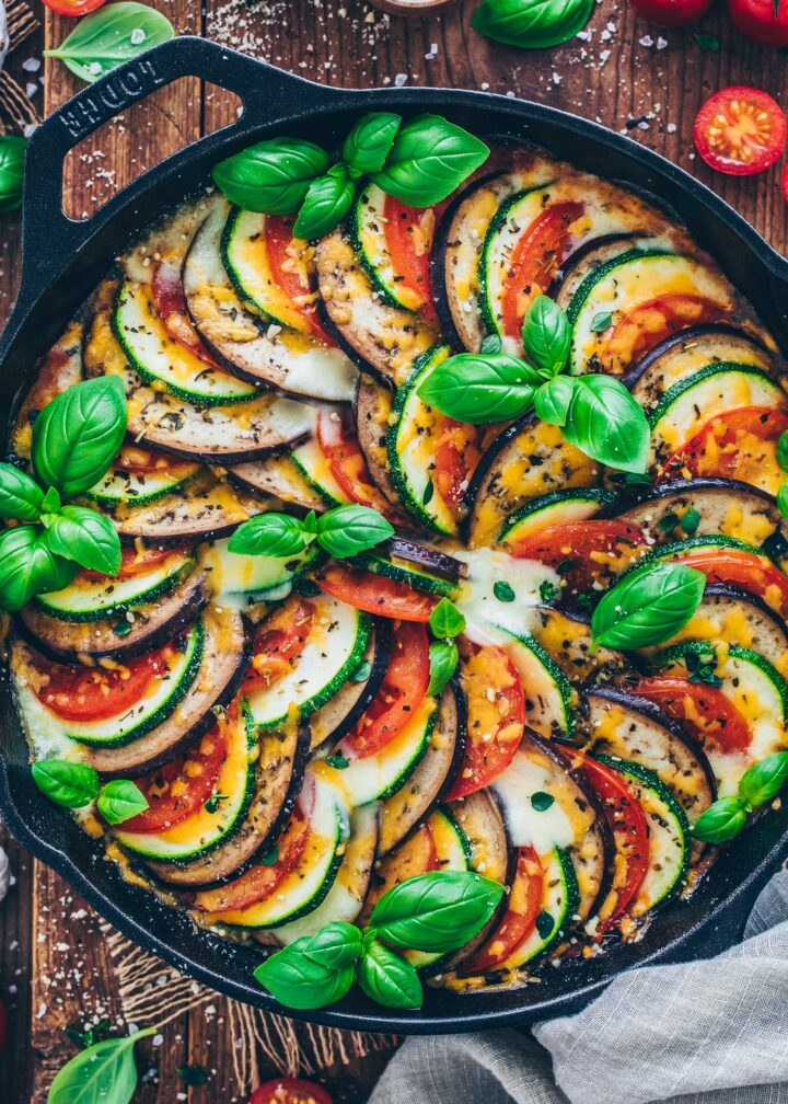 Ratatouille with eggplant, zucchini, and tomatoes in a skillet