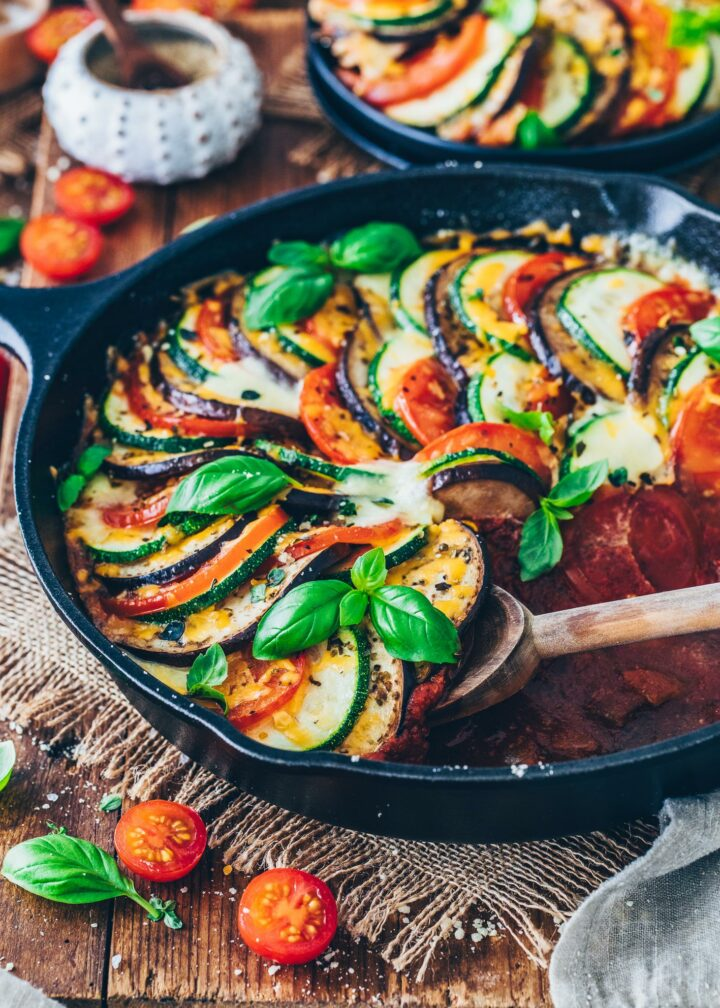 Ratatouille in a skillet garnished with basil