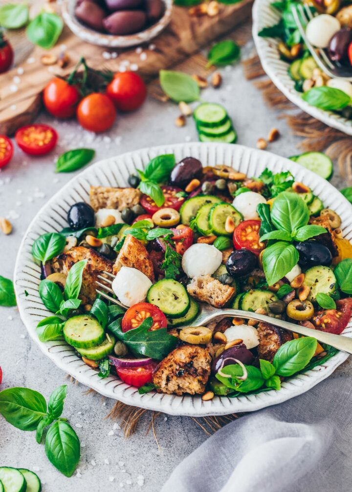 Italian Bread Salad with tomatoes, cucumber, onions, basil, garlic, vinaigrette and vegan mozzarella