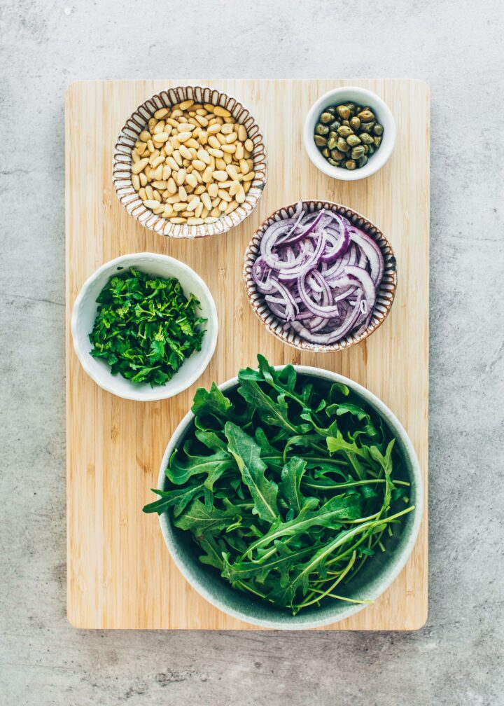 Arugula, pine nuts, red onions, capers, parsley, basil (ingredients for bread salad)