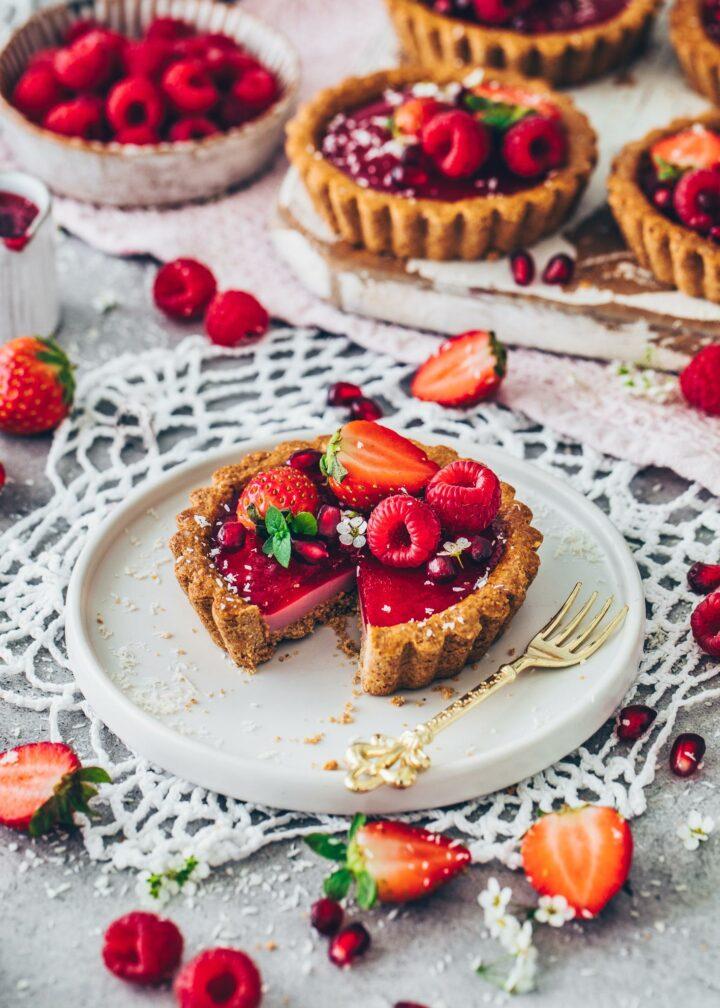 Vegan Raspberry Tarts with Granola Crust, Panna Cotta Filling and Strawberries
