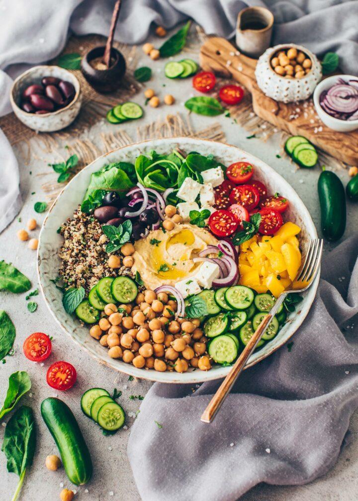 Rainbow Veggie Bowl with greens, vegetables, quinoa, chickpeas and hummus