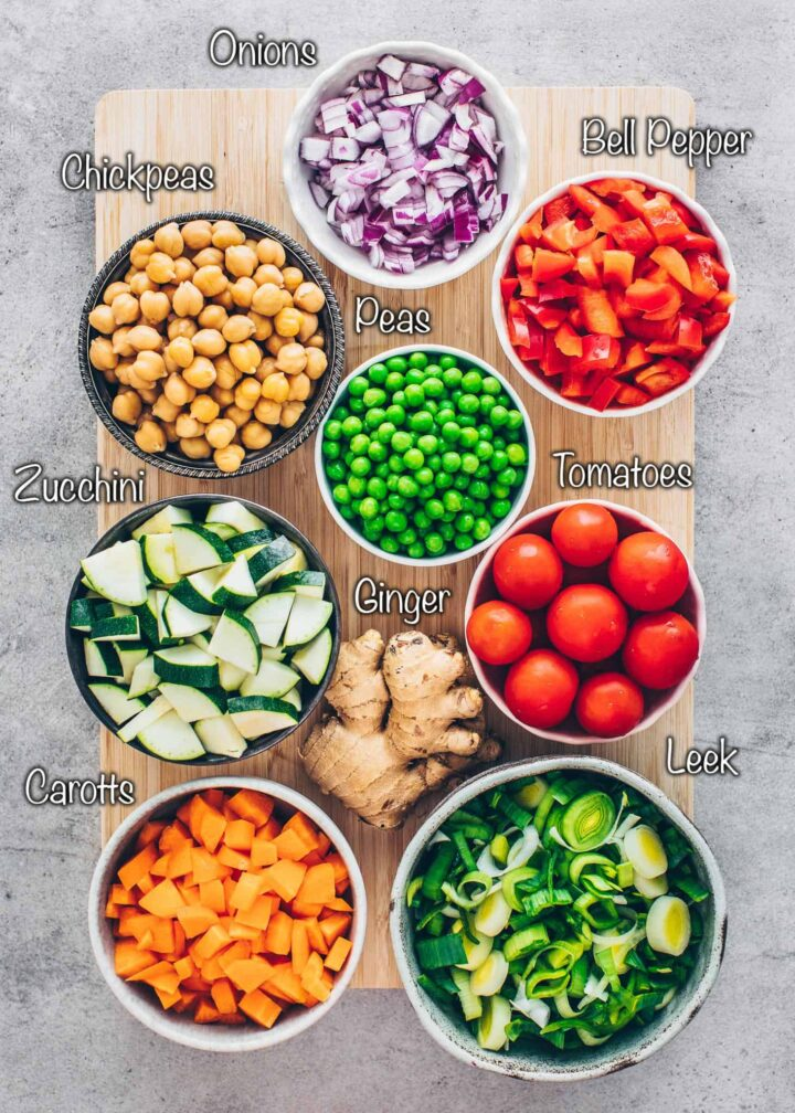 chickpeas, peas, red onions, tomatoes, bell peppers, ginger, carrots, zucchini, leek