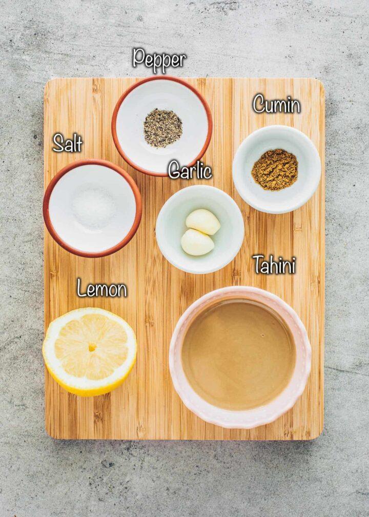 Baba Ganoush ingredients: tahini, garlic, cumin, salt, pepper, lemon juice
