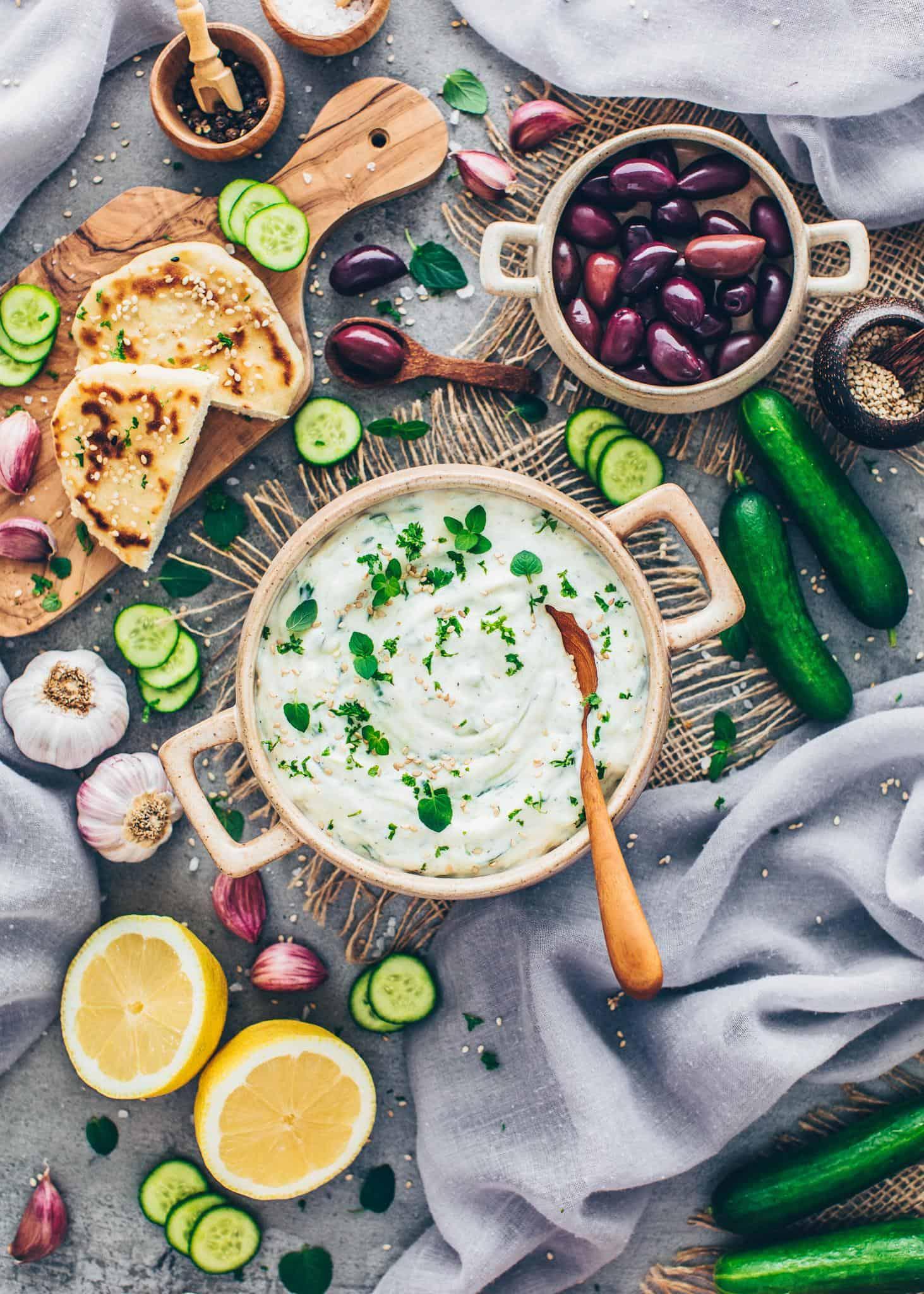 Tzatziki with cucumber, garlic, lemon juice, olive oil, olives, flatbread