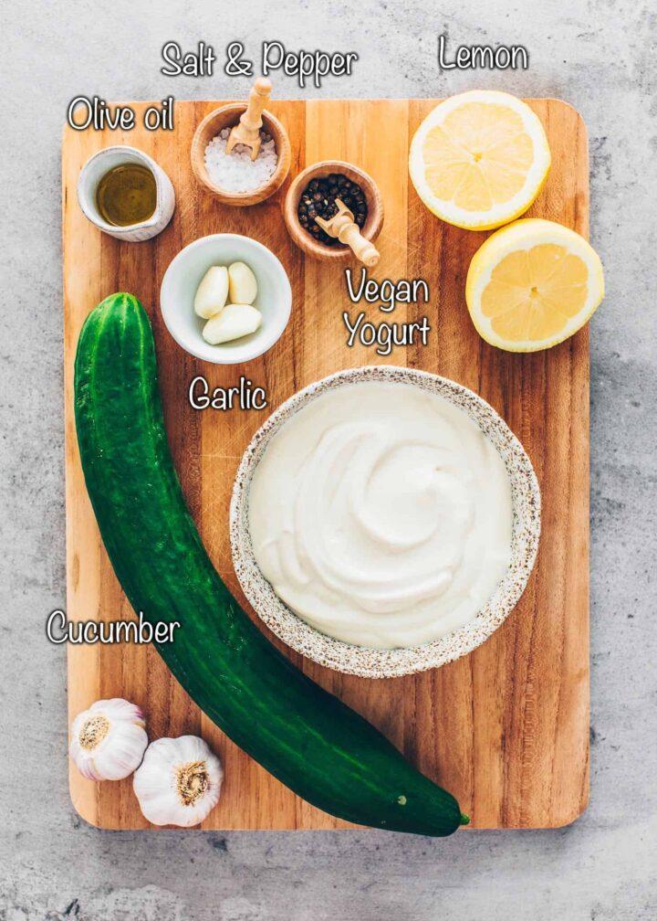 Dairy-free yogurt, cucumber, olive oil, garlic, salt, pepper, lemon juice
