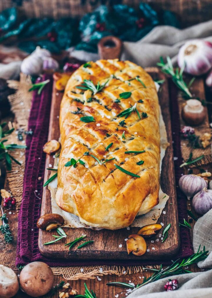 mushroom wellington, vegan roast filled with mushrooms, spinach, rice, nuts and wrapped in puff pastry